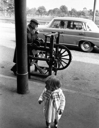 Knife Sharpener having a smoke break, Gorbals, Glasgow, 1968<br/>